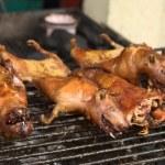 Постер, плакат: Roasting Guinea Pig in Banos Ecuador