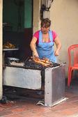 Woman Roasting Guinea Pig in Banos, Ecuador — Stock Photo