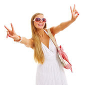 Pretty girl on vacation showing V sign — Stock Photo