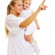 Pretty mother and baby looking ahead — Stock Photo