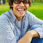 Happy teen guy in park — Stock Photo