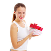 Smiling girl opens gift — Stock Photo