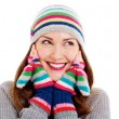Smiling pretty girl in mittens and hat — Stock Photo