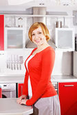Cute red-haired housewife at home — Stock Photo