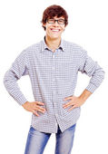 Young man with arms akimbo — Stock Photo