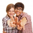 Happy young couple showing v sign - Stock Photo