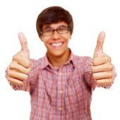 Šťastný chlap ukazuje palec — Stock fotografie