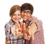 Happy young couple showing v sign — Stock Photo