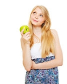 Pretty pensive blonde girl with green apple — Stock Photo
