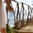 Woman with bottle of cold water — Stock Photo