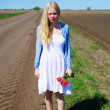 Stock Photo: Crying russigirl in field near road