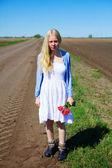 Crying russian girl in field near road — Stock Photo