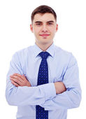Businessman with crossed arms — Stock Photo