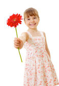 Smiling little girl with red flower — Stock Photo
