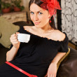 Beautiful woman with cup in cafe — Stock Photo