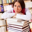 Stock Photo: Unhappy student in university library