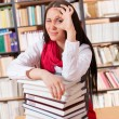 Foto Stock: Pretty student with books showing ok sign