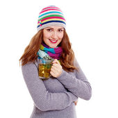 Smiling girl with cup of tea — Stock Photo