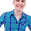 Young man smiling closeup — Stock Photo #27088793