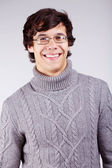 Smiling guy in sweater — Stock Photo