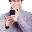 Confused guy shooting on smartphone — Stock Photo