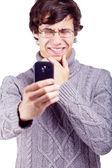 şaşkın adam akıllı telefon üzerinde çekim — Stok fotoğraf