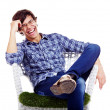 Relaxed guy laughing in armchair — 图库照片