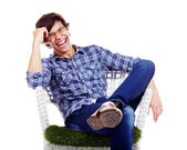 Relaxed guy laughing in armchair — Stock Photo
