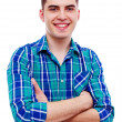Handsome guy with crossed arms over white — Stock Photo #30355985