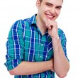 Joyful guy with hand on chin — Stock Photo