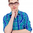 Stock Photo: Guy in glasses with hand on chin