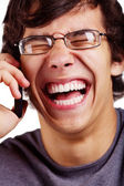 Laughing guy with cell phone closeup — Stok fotoğraf