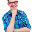 Cheerful guy in glasses with hand near chin over white — 图库照片