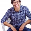 Laughing guy on chair over white — Stockfoto