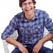 Laughing guy on chair over white — Stok fotoğraf