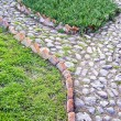 Stone Pathway with green grass - Stock Photo
