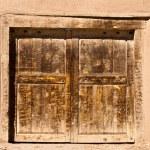 Old door in adobe wall — Stock Photo #22599287