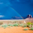 Rainbow on a Dark Desert — Stock Photo