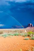 Rainbow on a Dark Desert — Stock Photo