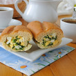 Stock Photo: Baguette stuffed with spinach, onion and egg