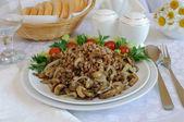 Buckwheat porridge with mushrooms and onions — Stock Photo