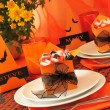 Stock Photo: Festive table with gifts for Halloween