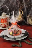 Sweets in the package on the festive table in honor of Halloween — Stock Photo