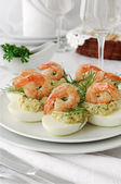 Eggs stuffed with spicy shrimp — Stock Photo