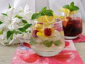 Fresh homemade lemonade with mint and raspberries — Stock Photo