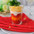 Salad of red and yellow tomatoes with mayonnaise and cheese - Stock Photo