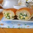 Baguette stuffed with spinach, onion and egg - Stock Photo