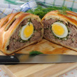 Meatloaf with egg and greens in the test - Stock Photo