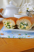 Baguette stuffed with spinach, onion and egg — Stock Photo
