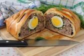 Meatloaf with egg and greens in the test — Stock Photo